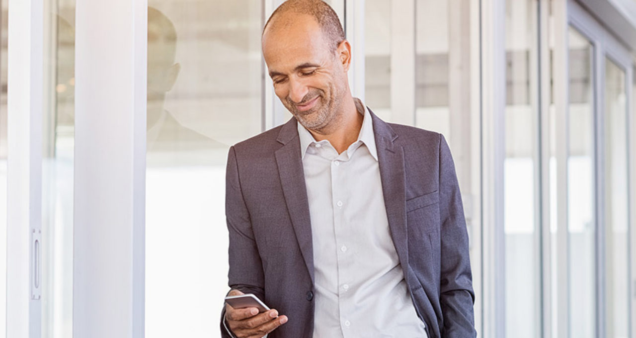 older man checking silversingles dating app