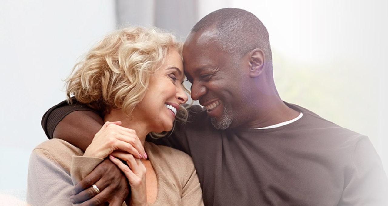 mature interracial couple hugging