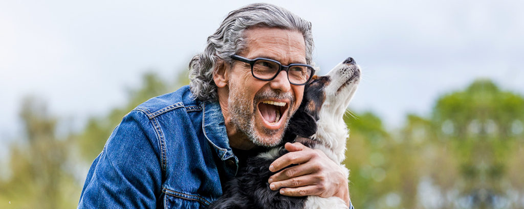 attractive older man with dog
