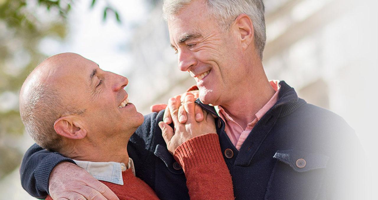 two older gay men hugging