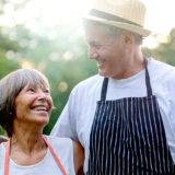 older couple outdoors BBQing