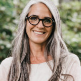 older attractive woman with glasses outside