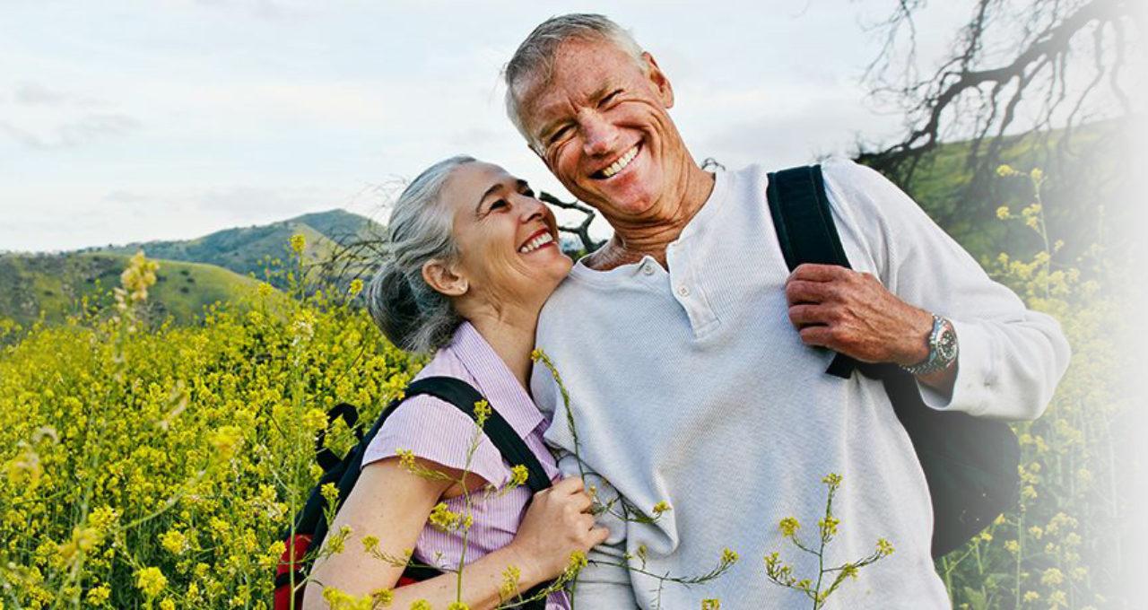 older couple outside in a field
