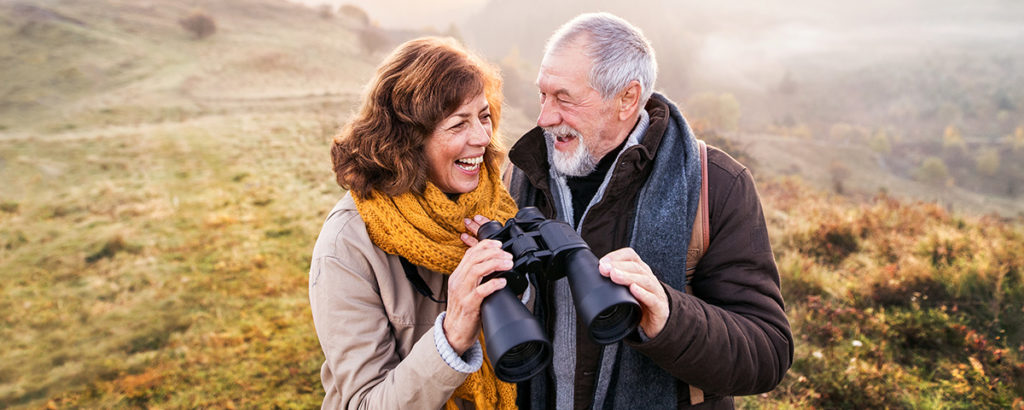 older couple outside birdwatching
