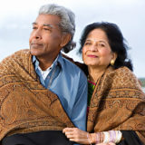 indian couple outside on beach
