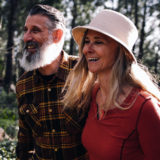 Happy over 50 couple in love, walking through the woods