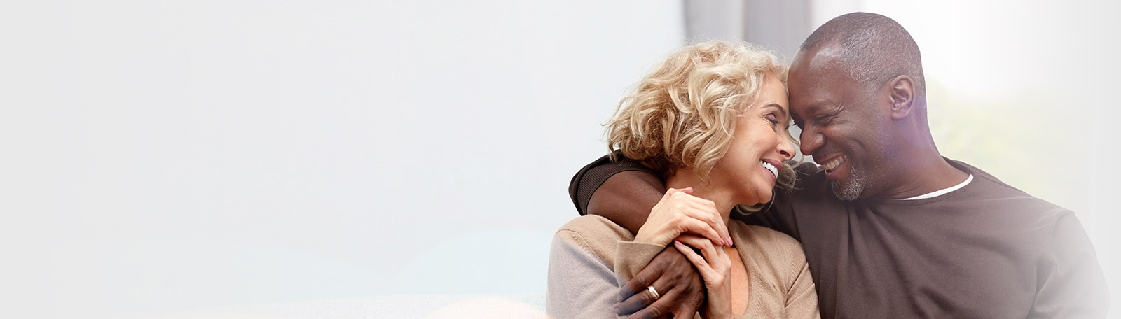 mature interracial couple hugging